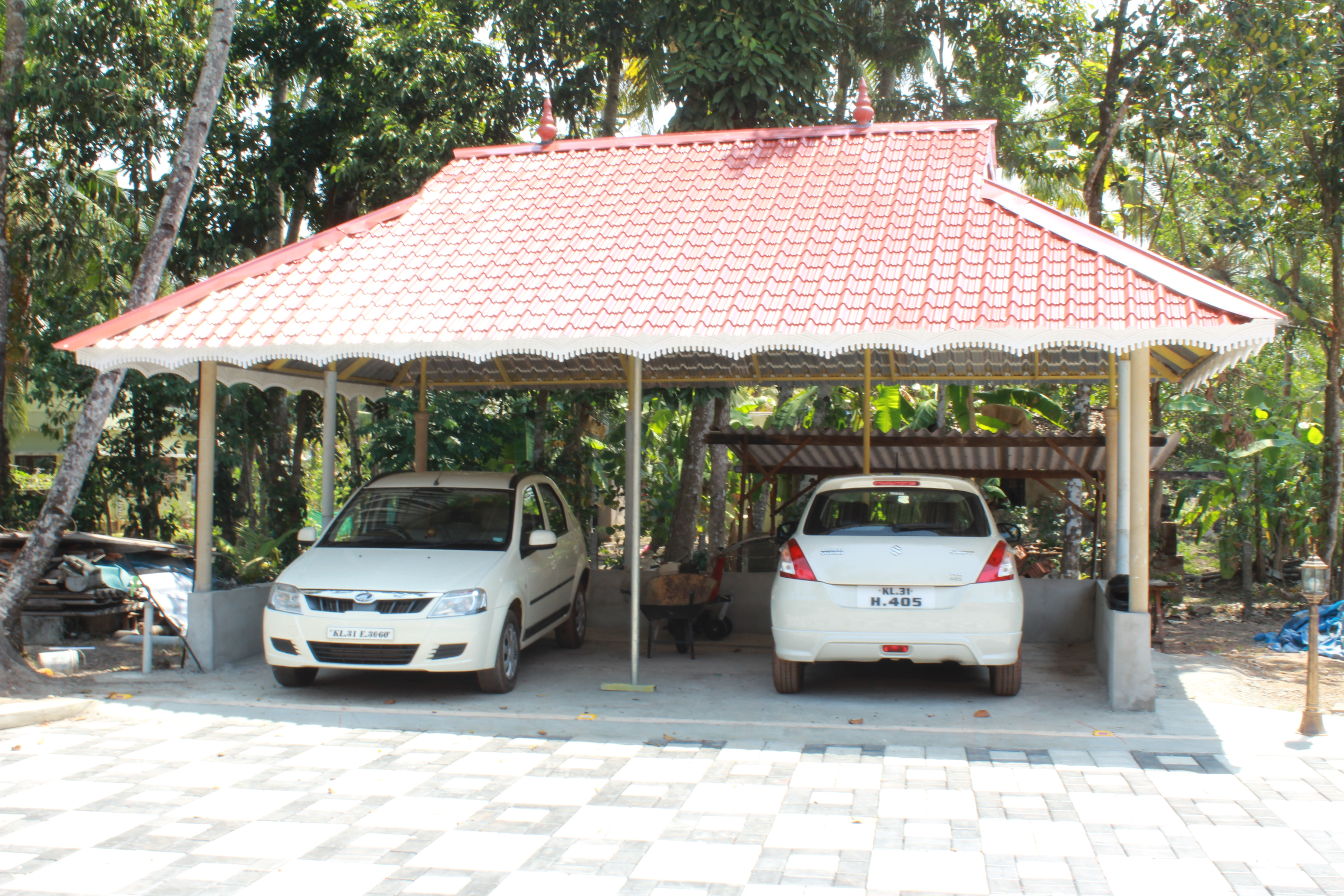 Car porch design kerala contemporary house front pictures for Car porch designs for houses